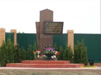 Памятник воинам – чекистам отряда им. Д.Н.Медведева, в с.Белоголовль